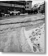 melting ice and snow on street surface holmen Honningsvag finnmark norway europe Metal Print