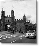 modern traffic driving past Entrance to Macroom Castle County Cork Ireland Metal Print