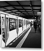 modern yellow u-bahn train sitting at station platform Berlin Germany Metal Print
