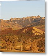 Moon Over Cimarron Metal Print by Eric Glaser