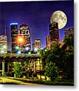 Moon Over Houston Metal Print by Lester Phipps