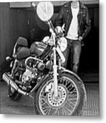 Motorbiker Looks On Dotingly Metal Print