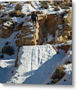 Mountain Biker Jumping With Snowy Metal Print
