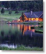 Mountain Lodge Reflecting In Lake At Metal Print