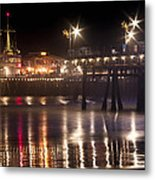 Night On Santa Monica Beach Pier With Bright Colorful Lights Reflecting On The Ocean And Sand Fine A Metal Print