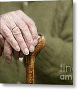 Old Hands Of A Senior On Walking Stick Metal Print