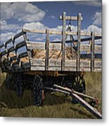 Old Hay Wagon In The Prairie Grass Metal Print