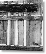 old patched up wooden fence using old bits of wood in snow Forget Metal Print