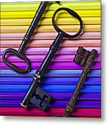 Old Skeleton Keys On Rows Of Colored Pencils Metal Print