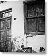 old weathered wooden door entrance to abandoned house 18 with window and cracked stucco walls in Los Banquitos Tenerife Canary Islands Spain Metal Print