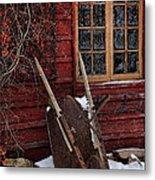 Old Wheelbarrow Leaning Against Barn In Winter Metal Print