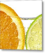 Orange And Lime Slices In Water Metal Print