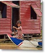 Paddling Through The Village Metal Print