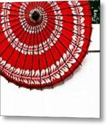 Paper Umbrella With Swirl Pattern On Fence Metal Print