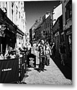 pedestrians and drinkers enjoying a sunday afternoon drink in the bunch of grapes pub high street Ga Metal Print