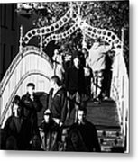 People Crossing The Hapenny Ha Penny Bridge Over The River Liffey In Dublin At A Busy Time Vertical Metal Print