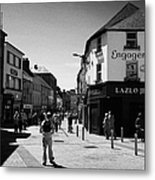 people walking down pedestrian area william street on a sunday Galway city county Galway Republic of Metal Print