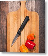 Peppers And Knife On Cutting Board Metal Print