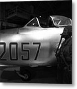 Pilot And His Airplane In The Hangar Metal Print