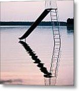 Playground Slide In Lake Metal Print