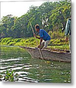 Poling A Dugout Canoe In The Rapti River In Chitwan National Park-nepal Metal Print