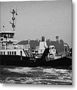portaferry ferry making its way out past the pier in rough seas and high winds on a stormy day Portaferry county down Metal Print