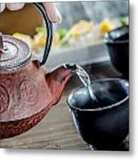 Pouring Japanese Tea Metal Print