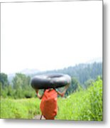 Pre Teen Girl Carrying An Inner Tube Metal Print