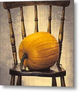 Pumpkin On Chair Metal Print