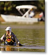 Racer Wading Across A River In An Metal Print