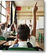 Rear view of boy with raised hand in class Metal Print