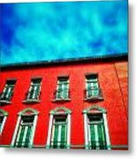 Red Against Blue Metal Print