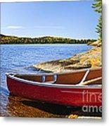Red Canoe On Shore Metal Print