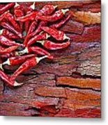 Red Chillies On Rustic Background Metal Print