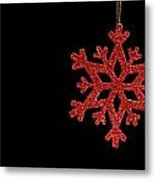 Red Snow Flake On A Black Background Metal Print