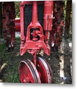 Red Tractor Metal Print by John Rizzuto