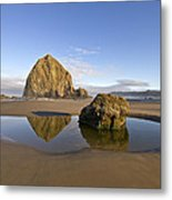 Reflection Of Haystack Rock At Cannon Beach Metal Print