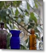 Row Of Colorful Glass Bottles  Metal Print