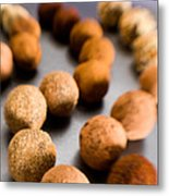 Rows Of Chocolate Truffles On Silver Metal Print