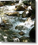 Running Over Rocks Metal Print