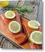 Salmon On A Cutting Board With Lemon Metal Print
