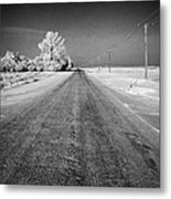 salt and grit covered rural small road in Forget Saskatchewan Canada Metal Print