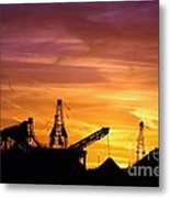 Sand Pit Silhouette  Sunset With Red And Yellow Sky Metal Print