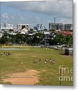 Schoolchildren Practicing On Playing Field With Singapore Skyline In Background Metal Print