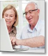 Senior Couple Using Laptop Metal Print
