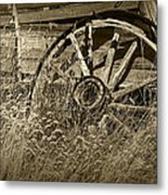 Sepia Toned Photo Of An Old Broken Wheel Of A Farm Wagon Metal Print