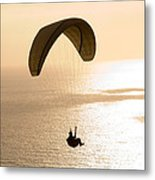Silhouette Of A Paraglider Flying Metal Print
