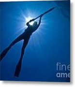 Silhouette Of A Young Woman Spearfishing Metal Print