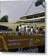 Singapore Flyer Along With The Sight-seeing Bus That Takes Tourists Around The City Metal Print