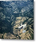 Small Plane Flying Over Mountains Metal Print